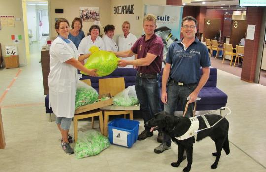 Gespaarde doppen van Result Laboratorium worden overgedragen aan KNGF